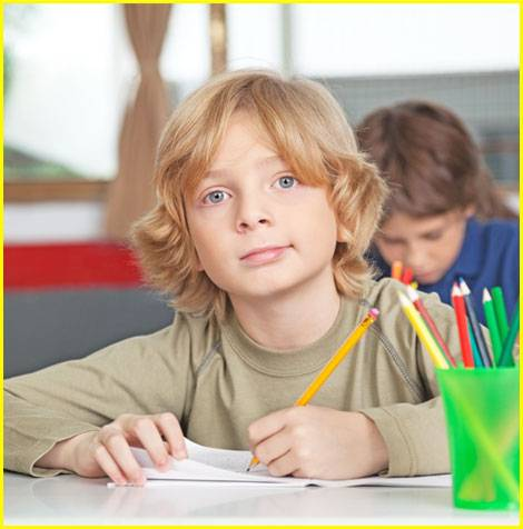 kid with pencil